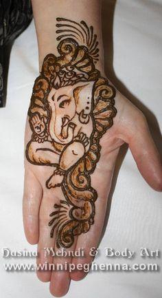 ganesh henna :D  Want henna tatoos of every symbol I love!