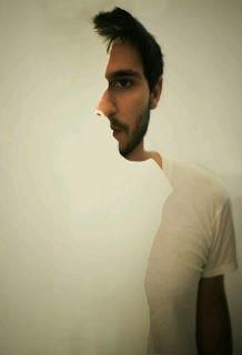 Stare at this pic carefully and you will see this man turn his face. (Not an animation) - Imgur