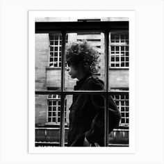 """American singer Bob Dylan pictured walking past a shop window during his visit to London. 3rd May 1966. Fine art print using water-based inks on sustainably sourced cotton mix archival paper. • Available in multiple sizes • Trimmed with a 2cm / 1"""" border for framing • Available framed in white, black and oak wooden frames Freddie Mercury, Gold Poster, Paris Poster, Kurt Cobain, Jimi Hendrix Poster, Bob Dylan Poster, Desenio Posters, Poster Shop, Buy Posters Online"""
