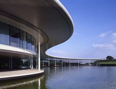 Foster + Partners designed the Technology Centre of McLaren. The building is designed to reflect the company& design and engineering expertise. Famous Architecture, Chinese Architecture, Futuristic Architecture, Architecture Details, Building Architecture, Unusual Buildings, Modern Buildings, Steel Structure Buildings, Sustainable City