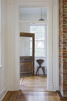 Cherner chair in entryway of historic Charleston home.