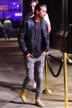 Scott Disick wearing Common Projects Suede Chelsea Boots and Blk Dnm Classic Bomber Jacket