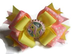 My Little Pony Hair Bow Fluttershy Pink Bow with Polka Print and Yellow Ribbon and Ribbon Spikes. $8.50, via Etsy.