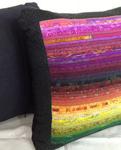 Quilted pillow in rainbow colors. Purples, gold and green. Mix and match.