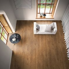 Warm and hard wearing wide wood effect flooring by Amtico Signature,