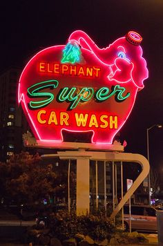 A Seattle landmark - pink elephant neon sign at night