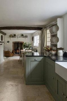 Pretty cottage kitchen in sage green www.melodymaison.co.uk