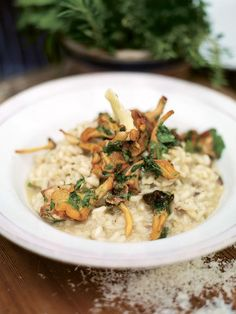 Jamie Oliver's Mushroom Risotto (Veganize it: substitute Vegetable broth for chicken, olive oil/earth balance for butter, nutritional yeast for parma cheese)