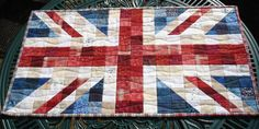 I would really like to make a Union Jack quilt, in fact I'm going to a special picnic in the Summer which would call for such a thing, particularly as I use a distressed Union Jack as the logo for my business MandycraftsUK ;0)