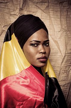 A woman wrapped in #UgandaFlag in a www.picturenative.com assignment highlighting the role of #women in #politics