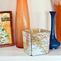 Set the Mood With a DIY Map Votive: Create just the right subtle glow with the help of dollar-store votives and an old atlas.