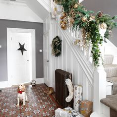 Looking for hallway decorating ideas? Be inspired by this traditional grey hallway with Christmas garland