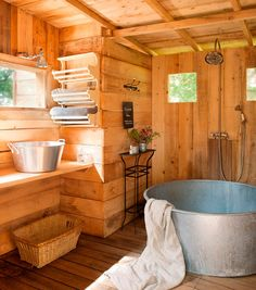 A little rustic but I like the bucket sink idea for a utility room or garden shed.