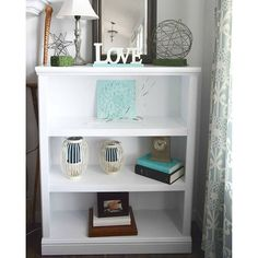 Painting a piece of furniture white does not mean dull and boring. I painted two shelves and took them from dark to stunning! #homedecor #diyblogger #instahome #coastaldecor #furnitureredo #livingroom