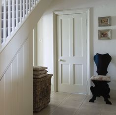 James White is a fresh off-white with a green base from Farrow & Ball seen here in an east-facing hallway
