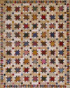 Scrappy star quilt with flying geese border, by Cindy Blackberg.