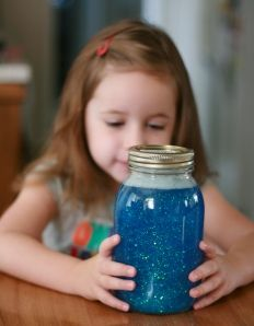 a 'calm down jar' - shake the jar and the child has to watch the jar until the glitter settles. great alternative to using 'time out' as calm down time. grownups can use this too!