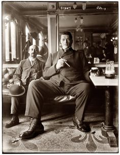 Big man enjoying a cigar and glass of beer in a New York tavern - 1908.
