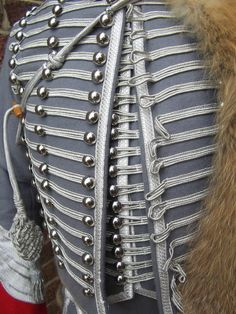Close-up view depicting an Officer's uniform of the French Napoleonic 3rd Regiment of Hussars 1809 - 1812.   Officers Uniform.