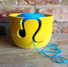Yellow 'Leo' zodiac yarn bowl by Earth Wool and Fire.