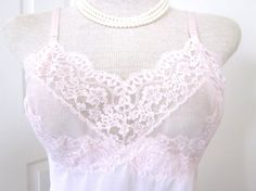 Check out this item in my Etsy shop https://www.etsy.com/listing/200700386/1960s-vintage-slip-pink-lace-full