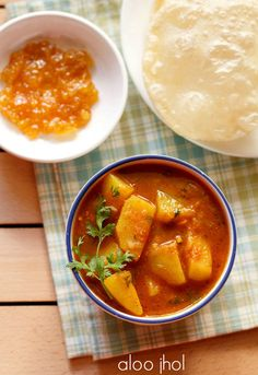 aloo tamatar k jhol recipe - spicy thin potato curry from the uttar pradesh cuisine. can be served with pooris, chapatis or steamed rice.