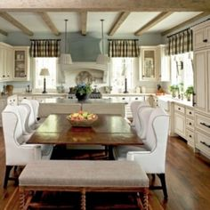 White wing-back chairs - very elegant country look