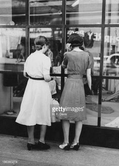 Two women looking at a display of autumn fashions at a shop in the West End of London 20th June 1941