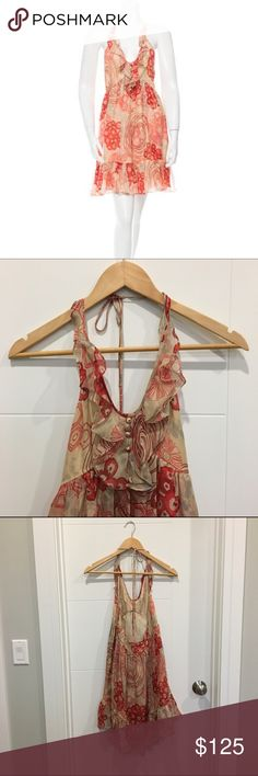 Jill Stuart Silk Halter Dress Red, burgundy and beige Jill Stuart silk halter mini dress with abstract floral print throughout, scoop neck, open at back and concealed zip closure at side. Never worn. 100% Silk Jill Stuart Dresses Mini