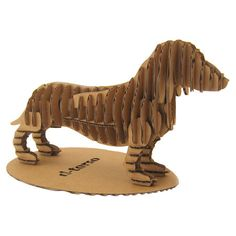 Cardboard cutout sculpture of a dachshund.   Product: SculptureConstruction Material: CardboardColo...