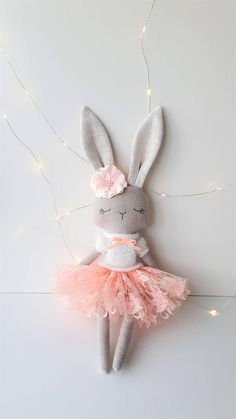 Sweet bunny heirloom doll made with lots of love and care. This bunny is: - handmade from natural linen fabric - 16 (41cm) tall ,without her ears - filled with hypoallergenic poly fiber - hand embroidered face - comes with removable clothes, scarf and hat. Only new fabrics and wool