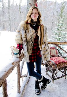 Sorels, plaid, fur, and a cup of tea. Everything in this picture makes me happy (including the dog)
