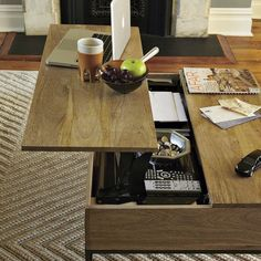 We love this small and practical Rustic Storage Coffee Table from West Elm. The minimal table is made from solid Mango wood and features a mechanical arm system that opens the top revealing hidden storage and providing an elevated work top for placin Coffee Table Desk, Lift Top Coffee Table, Rustic Coffee Tables, Coffee Table With Storage, Table Storage, Wood Storage, Rustic Table, Rustic Wood, Table Transformable