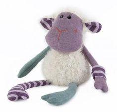 Bouillotte Mouton Tricot : Rembourrée de grains de blé et de fleurs de lavande séchés et traités, elle diffusera pendant longtemps une bonne odeur de lavande