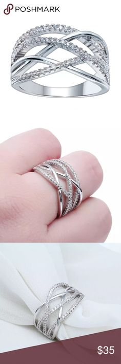 Sterling silver criss cross ring! This ring is gorgeous and so sparkly! Sterling silver filled with CZ's all around. This ring is perfect and would look stunning on anybody. Reasonable offers only please  Jewelry Rings