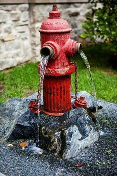 Old fire hydrant made into a fountain