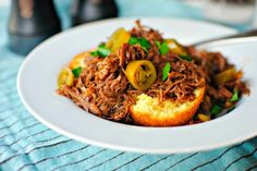 Sweet and tangy pulled pork piled high on top of cornbread. For a little heat, add slices of pickled jalapeno!