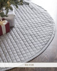 This Regency Dupioni Quilted Tree Skirt finds elegance in simplicity, offering a beautiful spread for your holiday display.