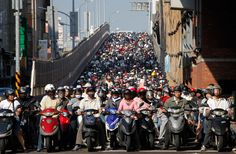 Motorists crowd at a junction during rush hour in Taipei, on October 29, 2009. There are more than 8.8 million motorcycles and 4.8 million cars on Taiwan's roads