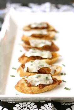 Mini Garlic Bread Slices With Caramalised Onions And Melted Cheese Canapes.