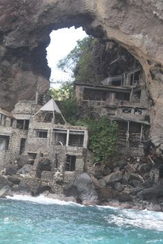 Abandoned house built into the cliff on one of the islands near Bequia.