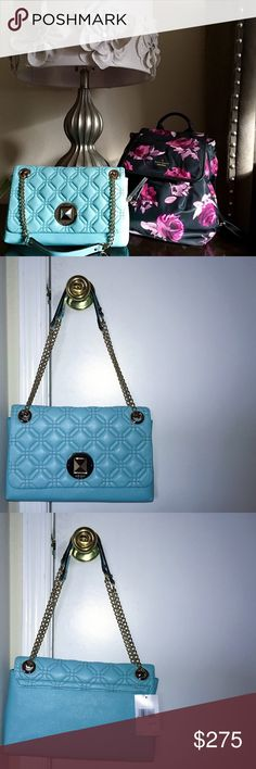 """Fabulous Kate Spade Handbag This gorgeous """"Cynthia"""" style bag features adjustable chains so it can be worn two ways- as a shoulder bag or as a handbag. It has an elegant quilted look, and is a drop dead beautiful shade of blue. New with tags. I consider all reasonable offers. kate spade Bags Shoulder Bags"""