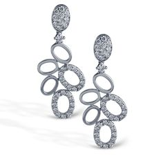 These striking 18K white earrings are comprised of 1.29ctw round white Diamonds.    TE243
