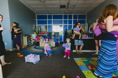How cool is this?? A store that hires moms and lets them bring their kids to work...without charging daycare tuition!