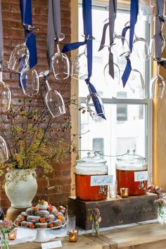 love this idea for a drink station - hang glasses by ribbons so guests can cut down their own! photo by Cyrience Creative Studios http://ruffledblog.com/fall-wedding-inspiration-with-a-cider-bar #weddingideas #drinkbar