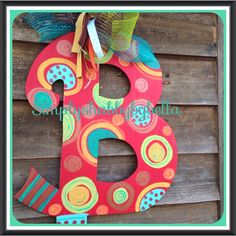Hey, I found this really awesome Etsy listing at https://www.etsy.com/listing/183502781/colorful-wood-initial-door-hanger