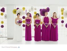 Paper wedding backdrop. bridesmaid dresses. different styles one colour.