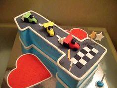 Number 1 First Birthday Cake (Racing Cars). This is a fondant cake in the shape of a number one in a racing car theme. Made back in 2009 for a boy named Etha. First Birthday Cakes, First Birthday Parties, Boy Birthday, First Birthdays, Birthday Ideas, Number 1 Cake, Numbers For Kids, Amazing Cakes, Cake Pops