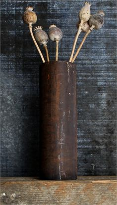 Have rusted pipes welded to make vases