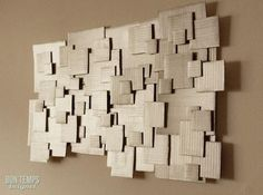A crafty piece of wall art from cardboard! You can also spray each piece a different color to brighten it up